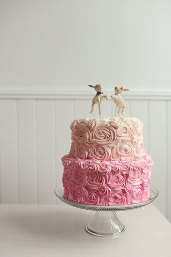 """Divine"" doesn't even begin to describe this sweet pink ombré cake.   Photo by Jessica May Photography via Style Me Pretty"