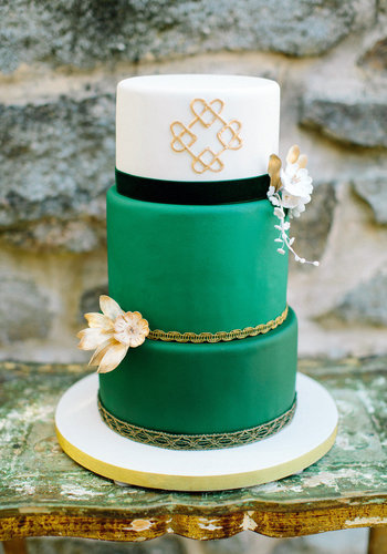 Sure, green is an unexpected color for a cake, but add gold hearts and gold ribbon, and it's as feminine as it gets.  Photo by Love by Serena via Style Me Pretty