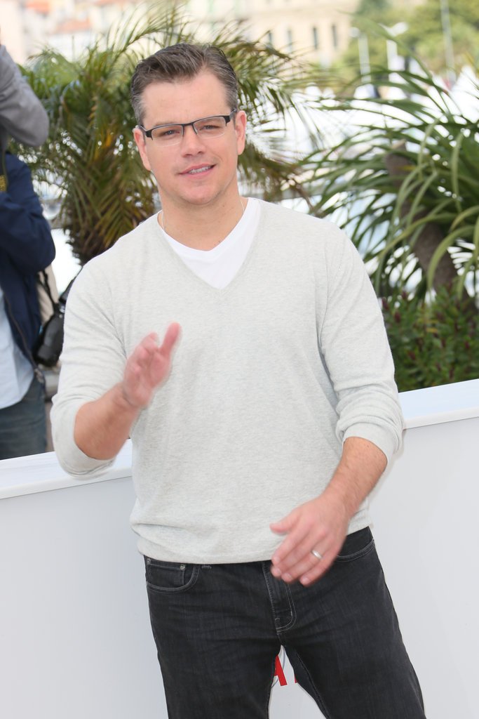 Matt Damon wore glasses and a white V-neck sweater.