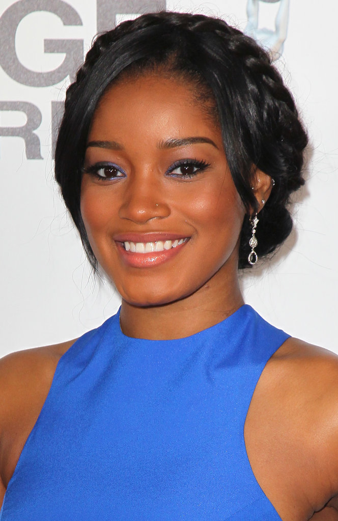 A more polished styling of milkmaid braids, like Keke Palmer wore at the NAACP Image Awards, is a great option for a Summer wedding.