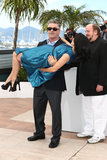 Alec Baldwin held his pregnant wife, Hilaria, in his arms during a photocall in Cannes.