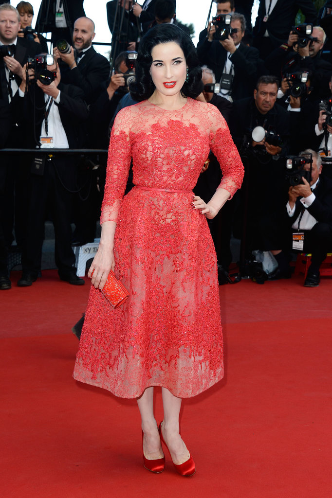 Dita Von Teese played to her sweeter side in a frilly red tea-length Elie Saab gown and red accoutrements — and her signature red lip! — to match.