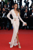 Joan Smalls was stunning in a plunging pale pink Emilio Pucci lace gown on the Cleopatra red carpet.