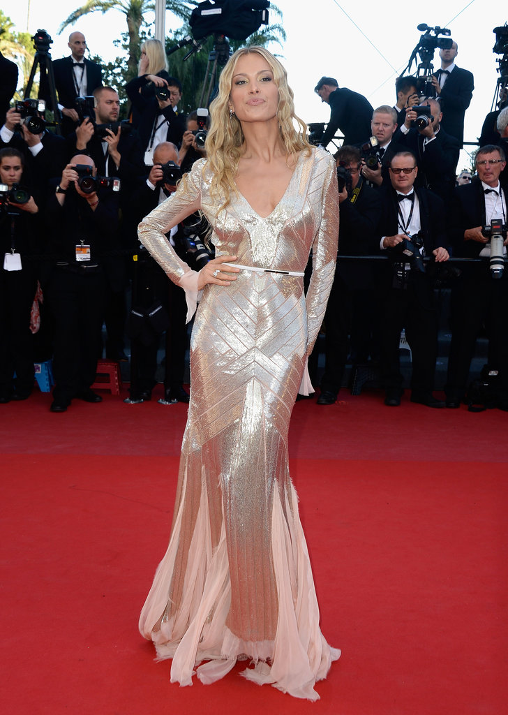 Petra Nemcova glowed in a gold-beaded, long-sleeved Emilio Pucci gown, Chopard jewels, Casadei heels, and mermaid waves at the Behind the Candelabra premiere.