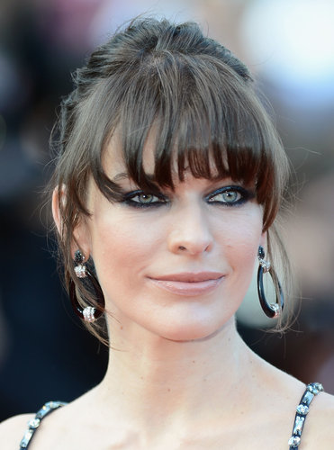 At the Behind the Candelabra premiere, Milla Jovovich wore her thick fringe around her face, highlighting her eyes with exaggerated black eyeliner.