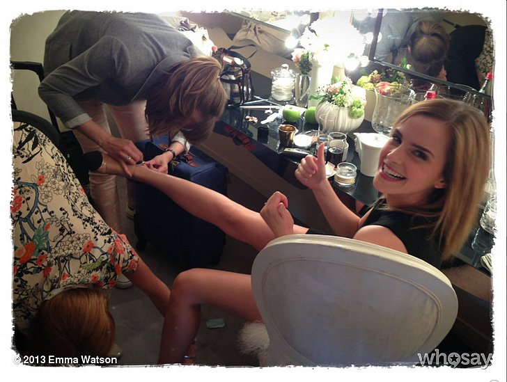 Emma Watson had to get some help, taking off her shoes after a long day. Source: Emma Watson on WhoSay