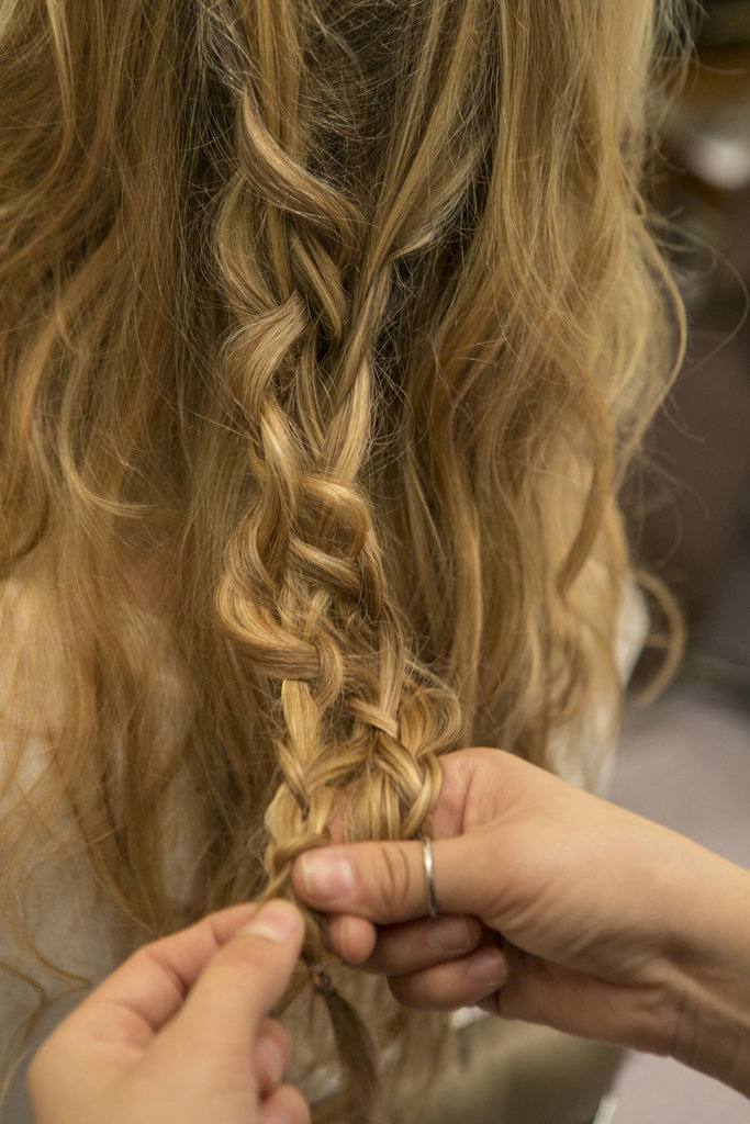 Continue to connect the braid all the way down and secure with another clear elastic. Be sure to also pull at the second braid to create even more texture.