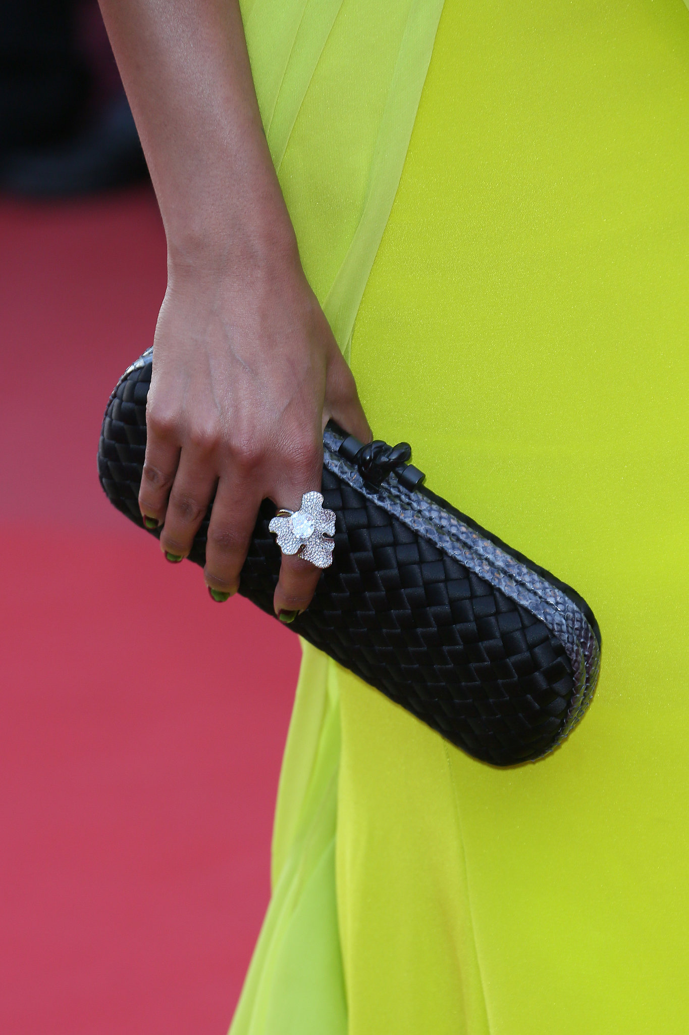 Selita Ebanks carried a black Alexander McQueen clutch and wore a Chopard ring.