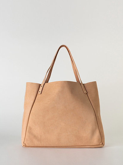Get this perfectly sized, go-anywhere L'Epicier leather bag ($95) just about any color you want — though we think this neutral suede finish would look particularly chic with skinny white denim.