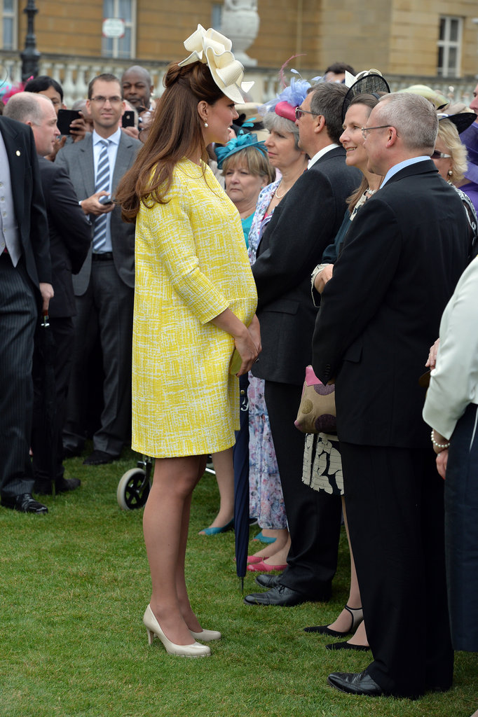 Kate showed off her growing baby bump in a pretty Spring coat.