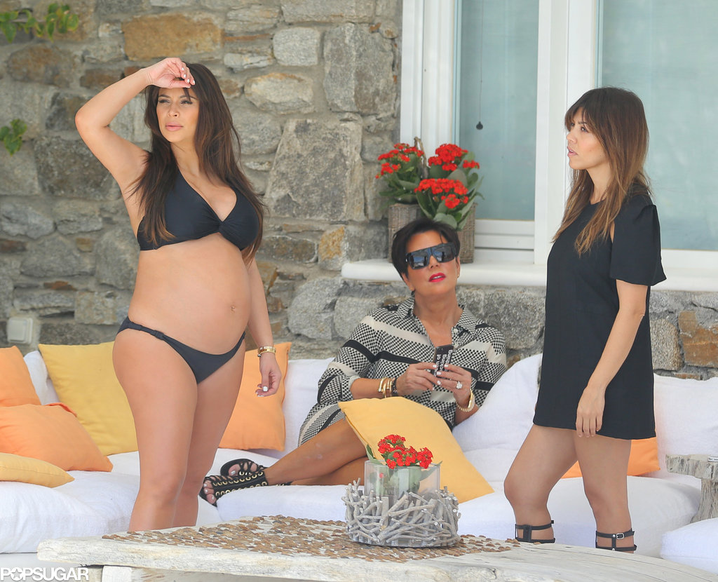 Kim Kardashian showed off her pregnant figure while on a family vacation in Mykonos, Greece, in April 2013.