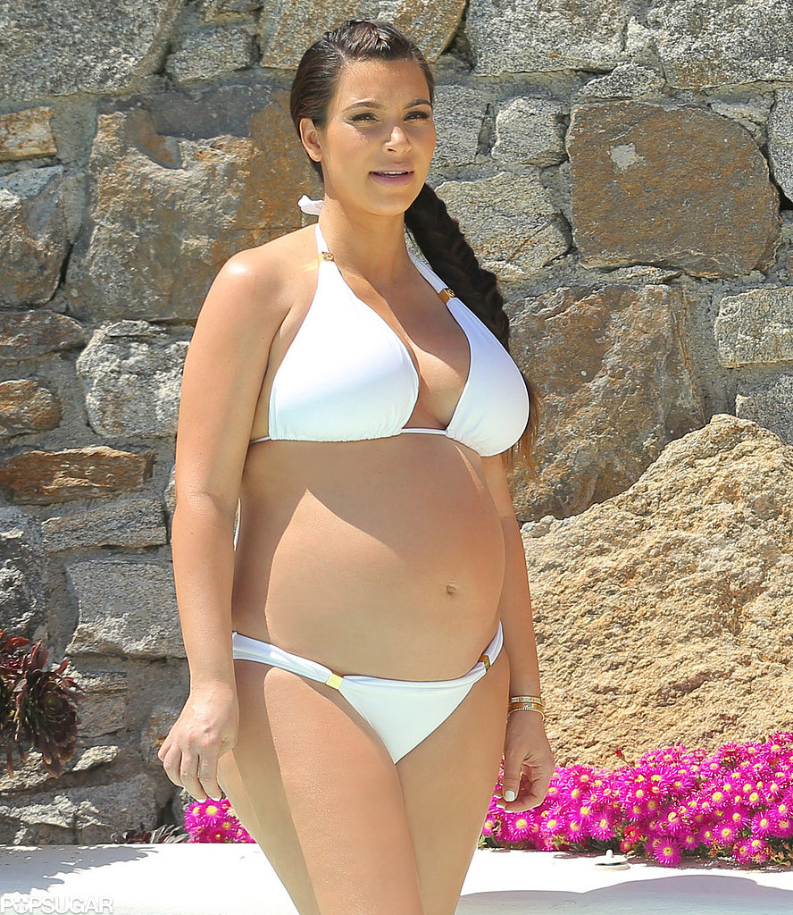 Kim Kardashian glowed in her white bikini in April 2013 while in Mykonos, Greece.