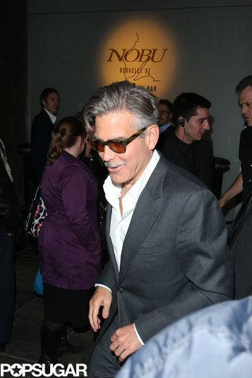George Clooney smiled as he left dinner in London on Wednesday night.