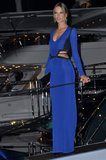 Alessandra Ambrosio made a sultry appearance at the Cavalli party in a slinky blue dress with cutouts at the sides.