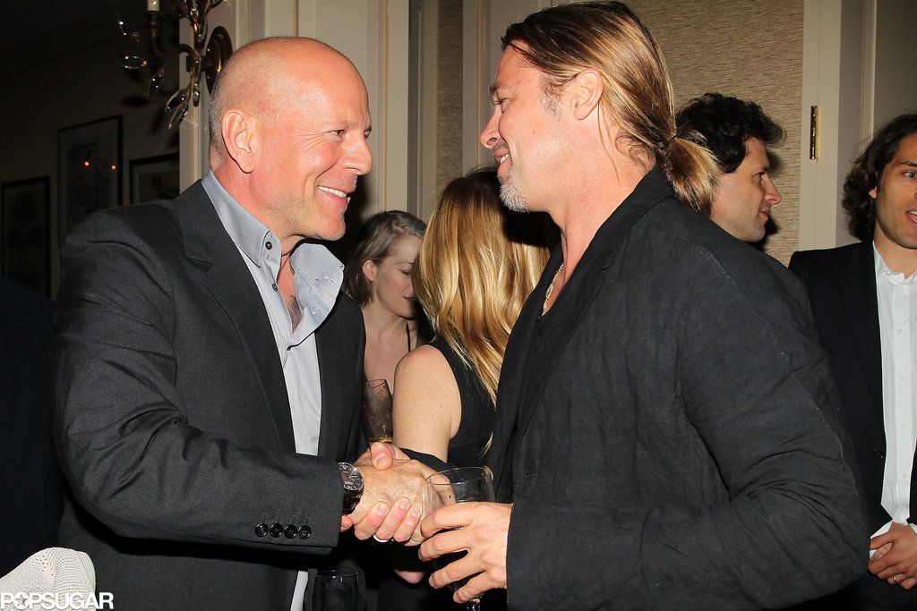 Brad Pitt chatted with Bruce Willis at the screening.