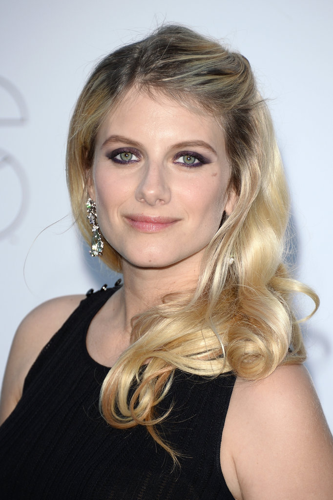 Deep plum shadow added a surprise element to Melanie Laurent's red carpet look, with her bangs strategically pulled back to show off her eyes.