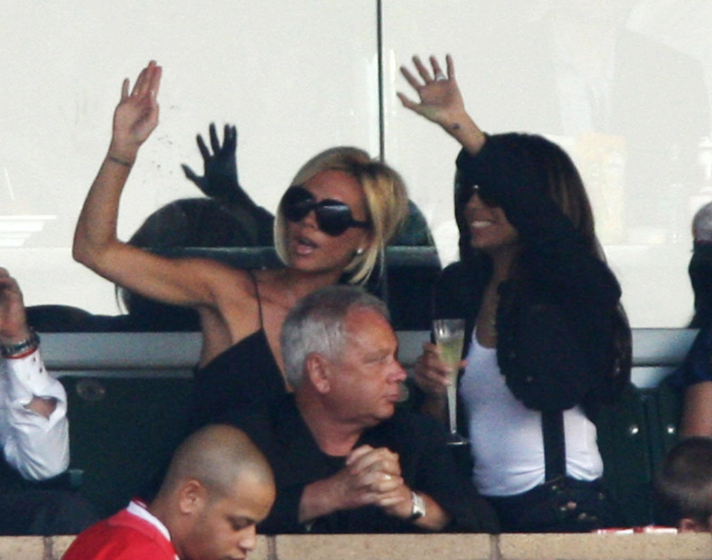 Victoria Beckham and her friend Eva Longoria waved to pals in the stands at a July 2007 Galaxy game.