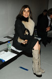 Carine Roitfeld sticks to bone and black, but keeps it from being boring via a flash of skin and a furry neck warmer.