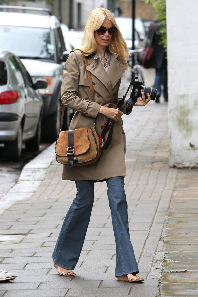 Why not work a '70s vibe when the temperature dips? Claudia Schiffer nailed the look in a classic trench and flared jeans.