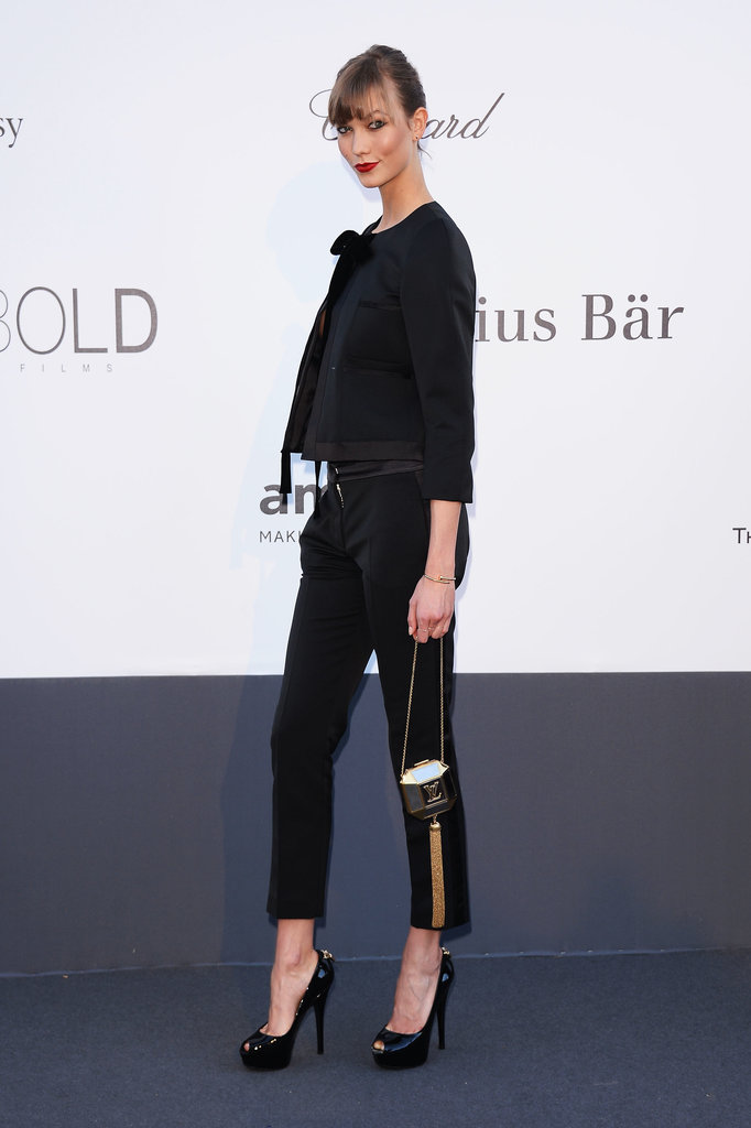 Karlie Kloss skipped the formal gown entirely for a sleek, tailored pantsuit from Louis Vuitton. She opted for an extraslim silhouette, cropped at both the ankles and wrists.
