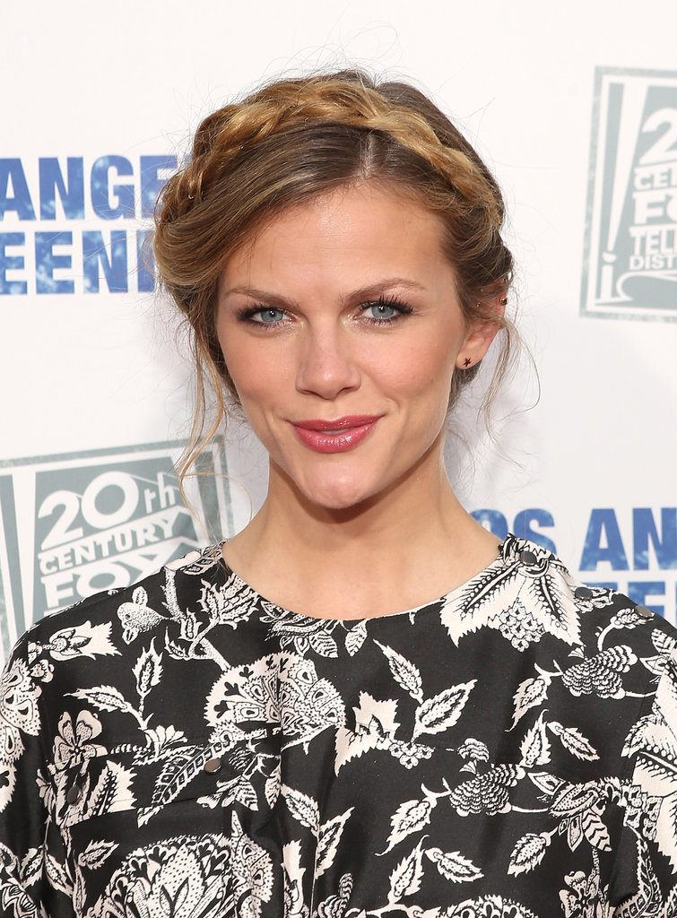 Perfect for Summer, Brooklyn Decker wore a pretty braided updo that's easy to re-create. Part your hair on top and then create pigtail braids (no french braiding necessary). Drape them overtop your head and pin to secure. Be sure to tuck in the ends for a seamless look.