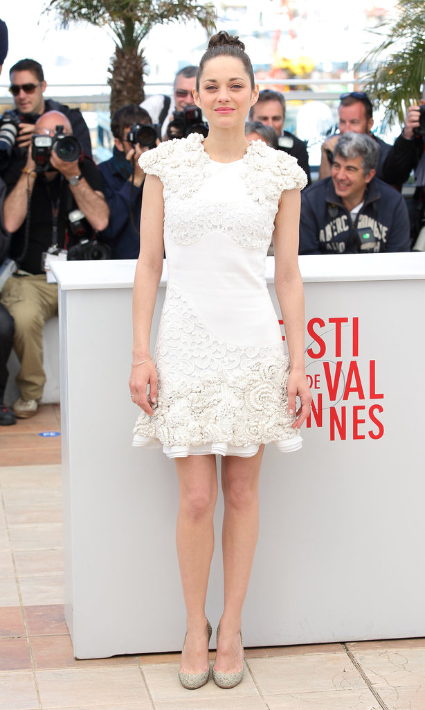 Marion Cotillard showed her panache in a white Alexander McQueen 3D flower-embroidered dress at the Immigrant photocall.