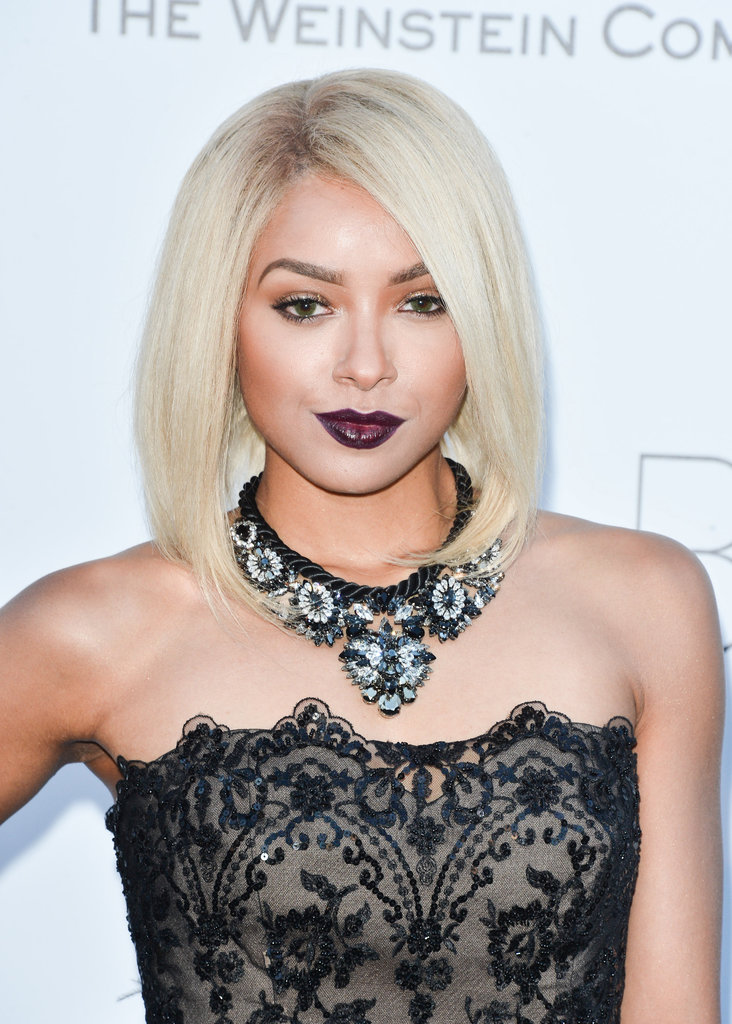 Kat Graham went for a moody dark purple lipstick that contrasted with her platinum blond mane.