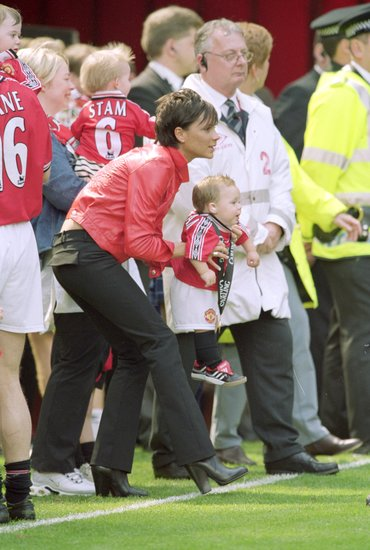 Victoria and Brooklyn Beckham cheered from the sidelines after Manchester United's May 2000 championship win.