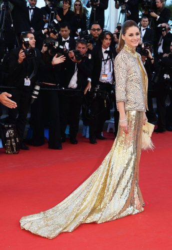 Proving she really is a style golden girl, Olivia Palermo went full-carat-ahead in a long Roberto Cavalli gown and jacket for The Immigrant premiere.