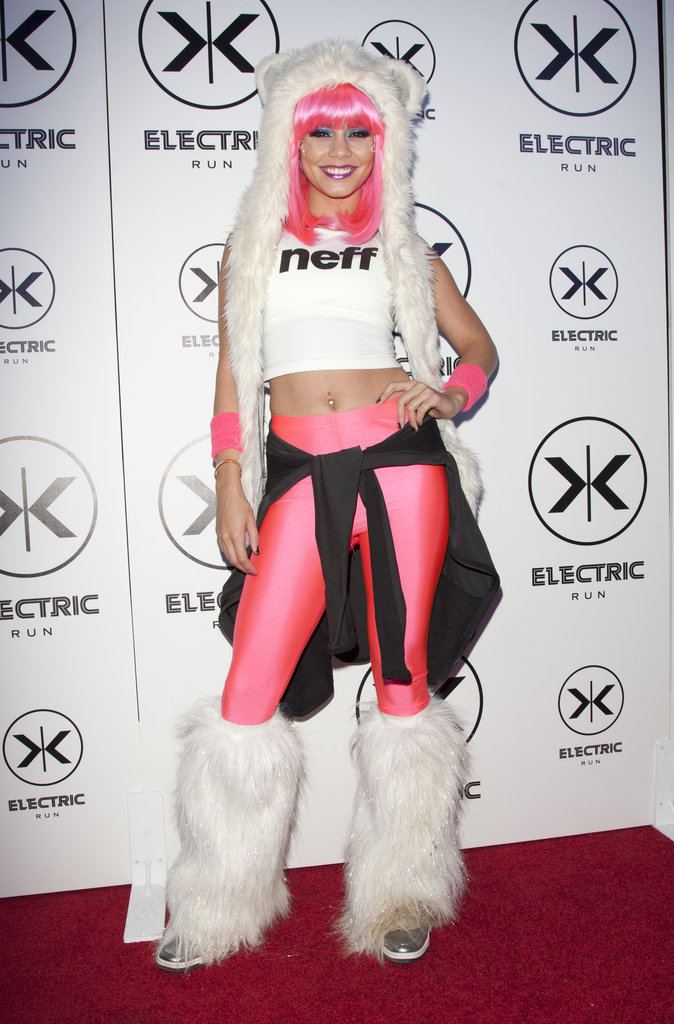 Vanessa Hudgens wore SpiritHoods, furry boots, and pink leggings.