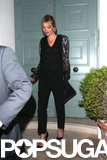 Kate Moss wore heels and black pants.