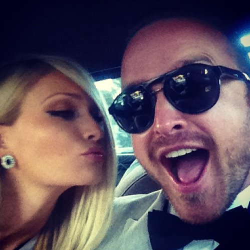 Aaron Paul kicked off his wedding weekend when he shared a photo of soon-to-be-wife Lauren Parsekian giving him a kiss on their way to their rehearsal dinner. Source: Instagram user glassofwhiskey