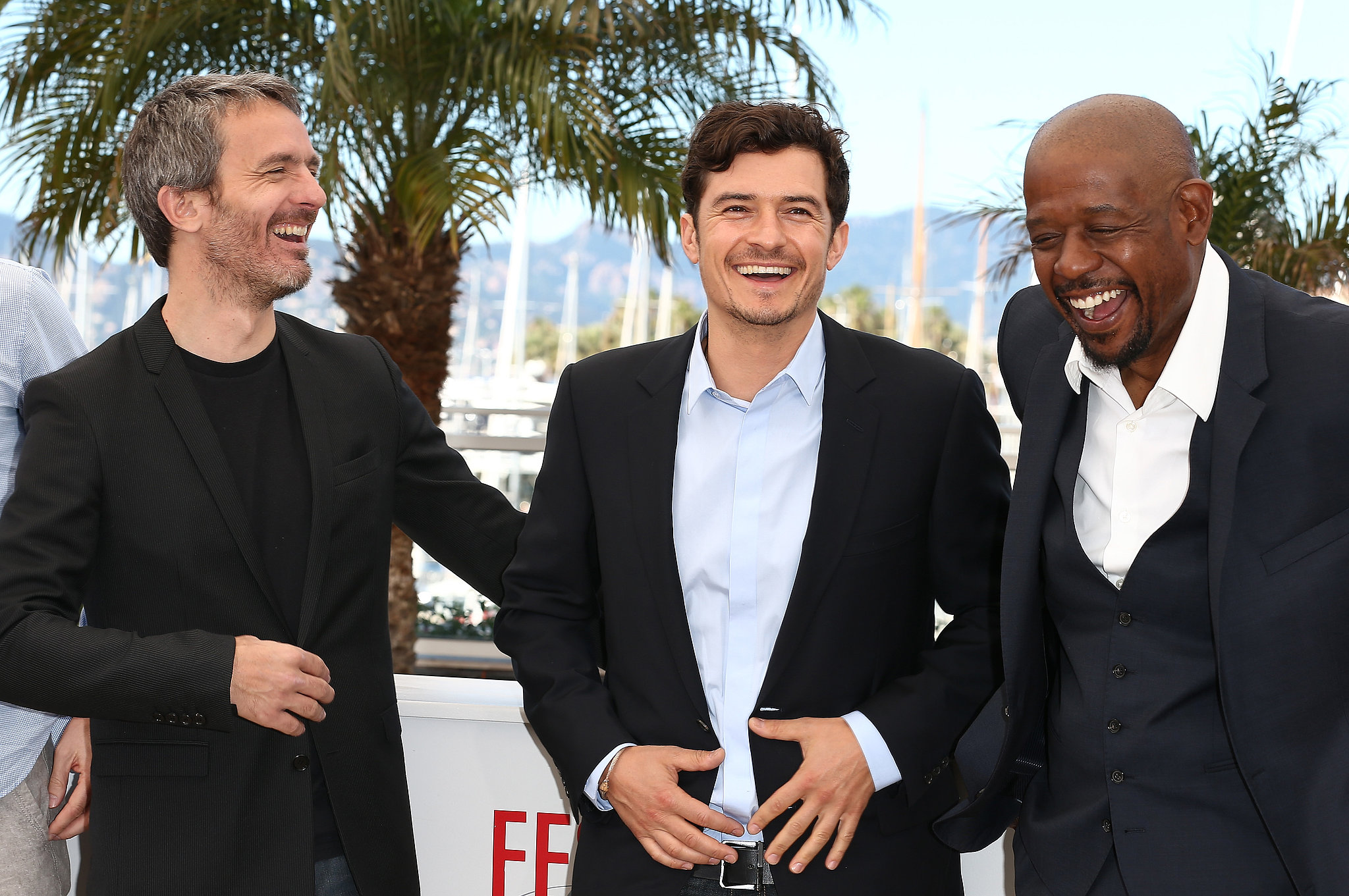 Orlando Bloom, Forest Whitaker, and Jérôme Salle laughed at the Zulu photocall in Cannes on Sunday.