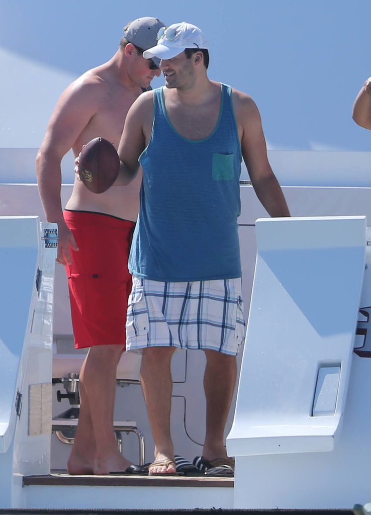 Tony Romo held on to a football while getting off a yacht.