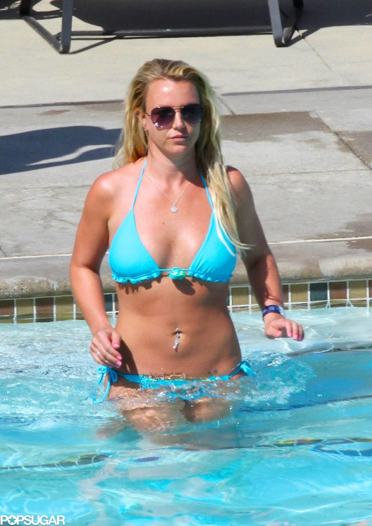 Britney Spears wore a blue bikini while spending time by the pool.