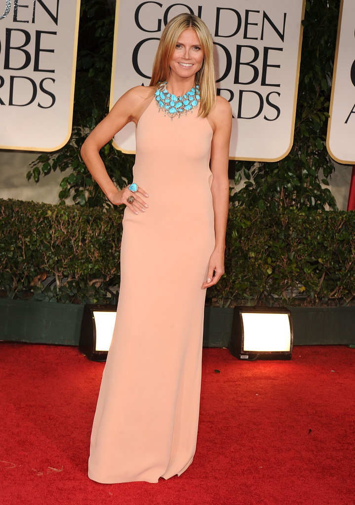 For Heidi Klum's 2012 Golden Globe ensemble, it was all about the accessorizes as the blond stunner topped her peach Calvin Klein halter with a jaw-dropping turquoise Lorraine Schwartz necklace and matching rings.