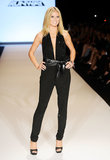 Heidi hit the catwalk in a double dose of sequins — a plunging Michael Kors jumpsuit and platform peep-toes — at the Project Runway Spring 2012 show in NYC.