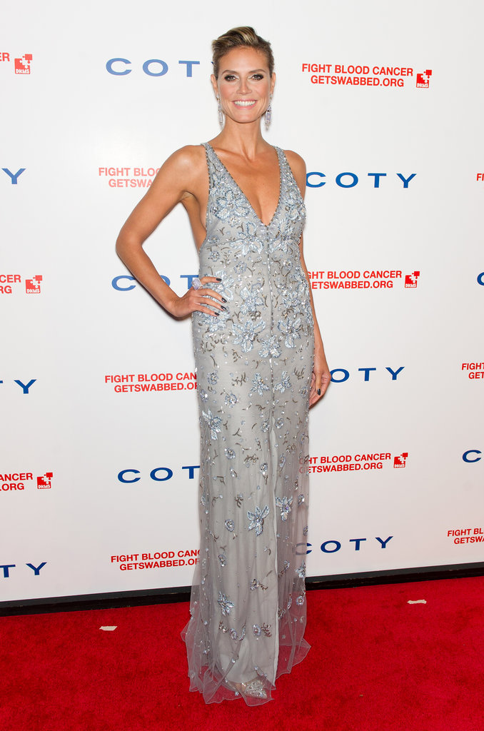 Heidi worked her signature silhouette, plunging neckline, and stem-baring thigh-high slit in a floral-overlay Temperley London confection at a cancer gala in April 2012.