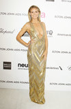 Klum looked statuesque in a plunging gold Julien Macdonald gown at Elton John's 2013 Oscars viewing party in West Hollywood.