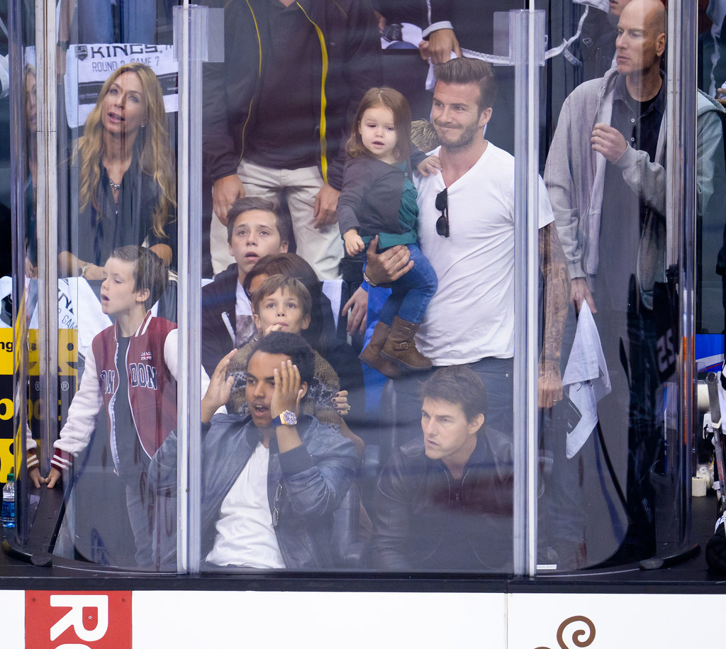 David Beckham and his family sat behind Tom Cruise and his son, Connor Cruise, at an LA Kings game.