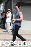 Colin Farrell showed off his tattoos.