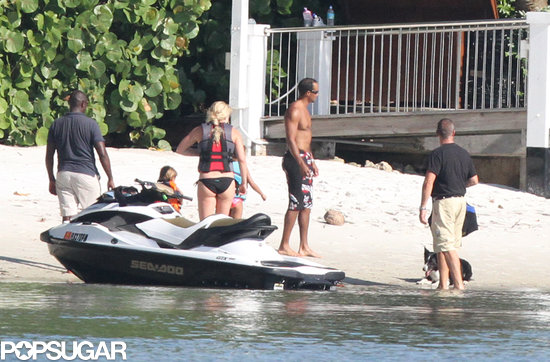 Bikini-clad Lindsey Vonn and boyfriend Tiger Woods took his kids for a ride on jet skis in Palm Beach.