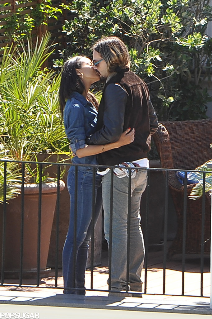 Zoe Saldana and Marco Perego kissed on their balcony.