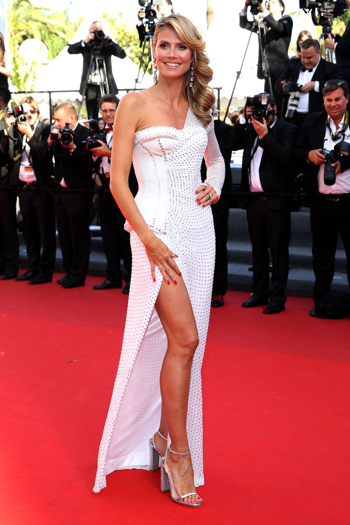 It's almost impossible not to stare at Heidi Klum's thigh-high slit and asymmetrical-cut, bustier-style Versace number.