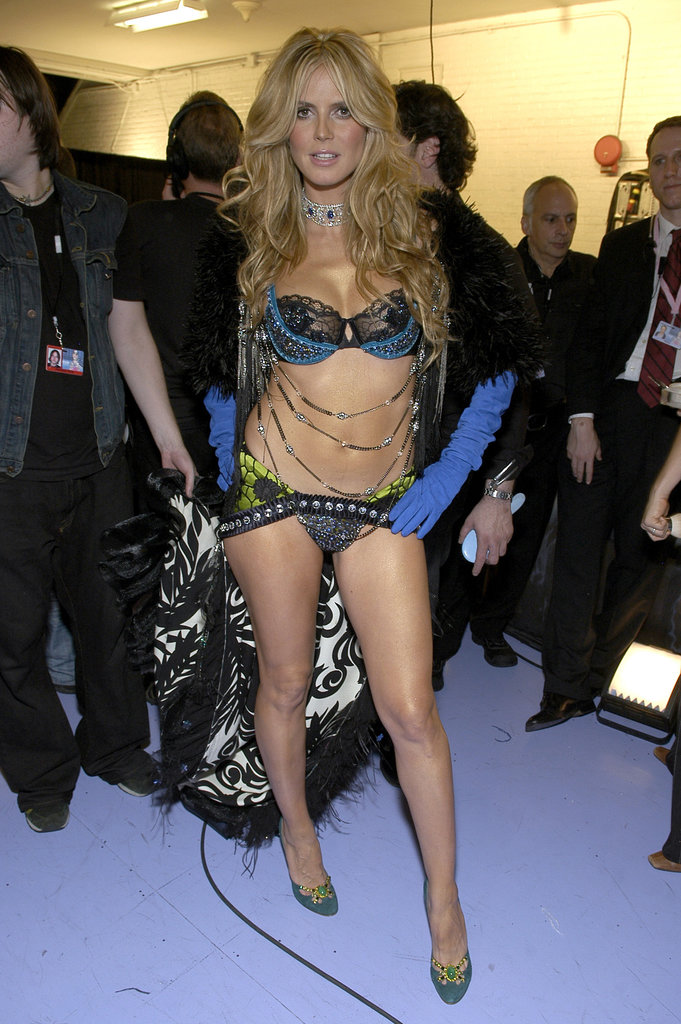 In November 2005, Heidi Klum modeled a Victoria's Secret look backstage at the fashion brand's show.