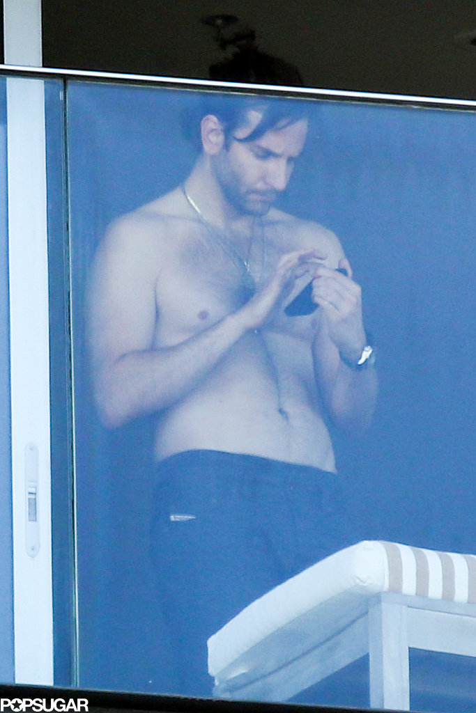 Bradley Cooper looked at his cell phone while on his hotel balcony in Brazil.