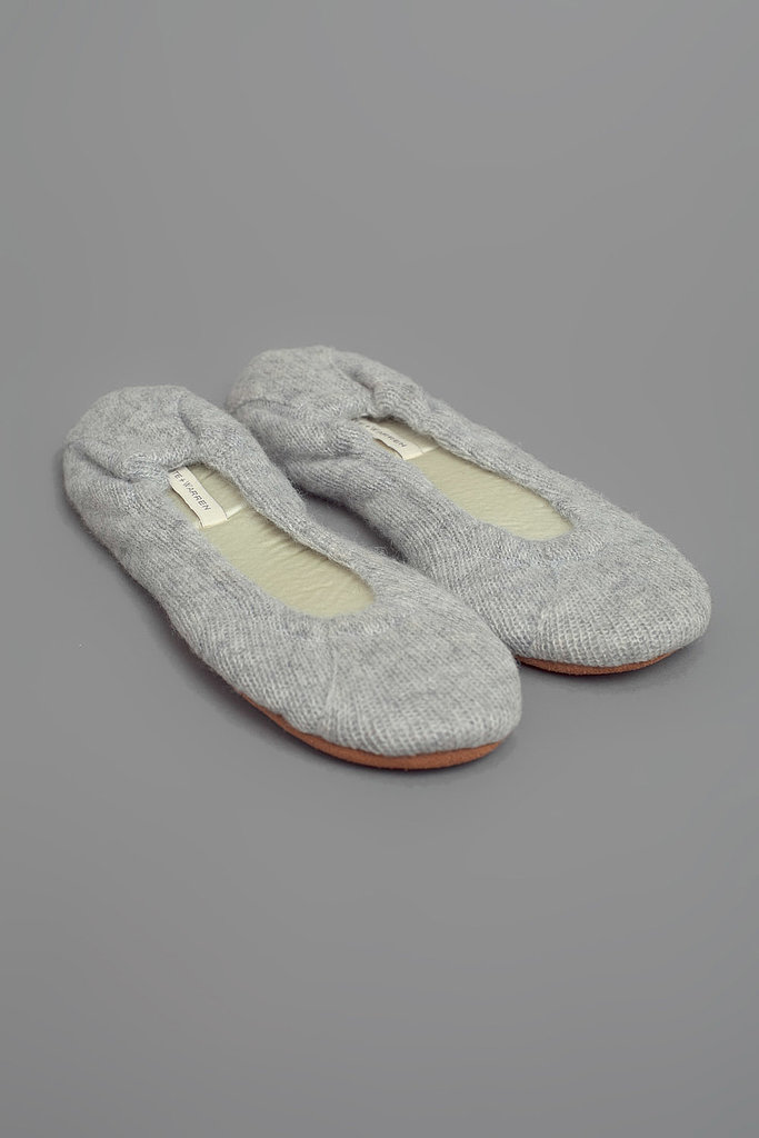 An unfamiliar hotel room will instantly feel homier if you're padding around in White + Warren's cashmere slippers ($185).