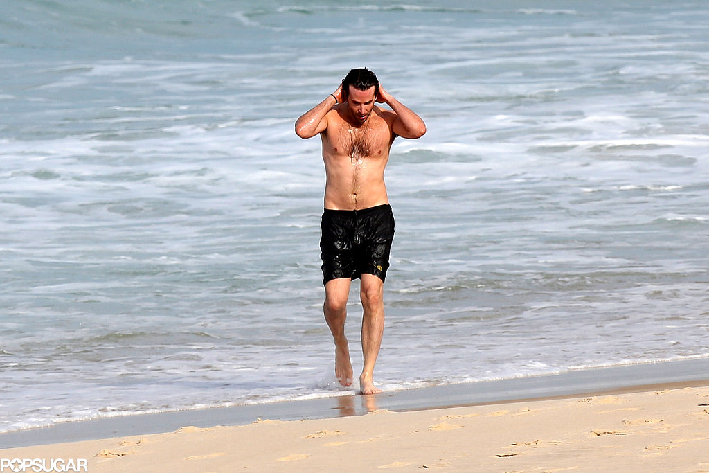 Bradley Cooper walked on the sand.