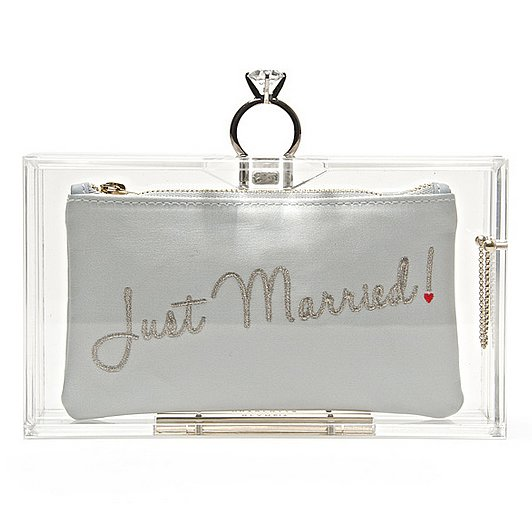 "Between the ""Just Married"" inscription and the diamond ring clasp, we can't think of a more whimsical way to walk down the aisle than with this Charlotte Olympia lucite Marry Me Pandora clutch ($881)."