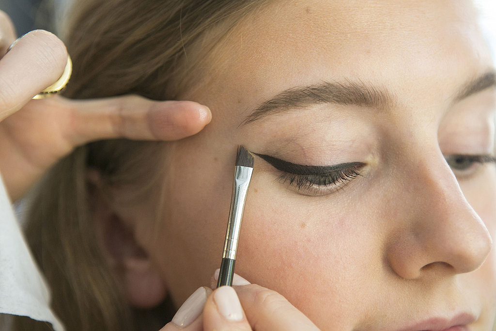 Use a brush or cotton swab soaked in a makeup remover to clean up and perfect the edges.
